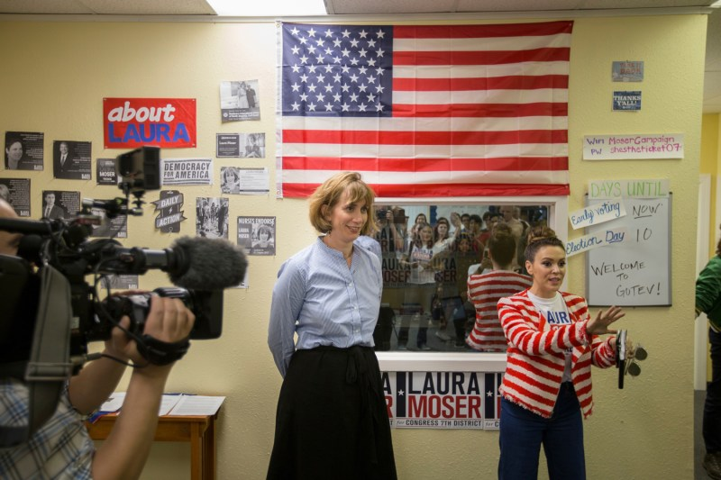 Laura Moser, one of seven Democrats competing for a Houston Congressional seat, and actress and activist Alyssa Milano speak to campaign volunteers on Saturday. In an unusual move, Moser was called out by her own party when the Democratic Congressional Campaign Committee called her too liberal for the district.