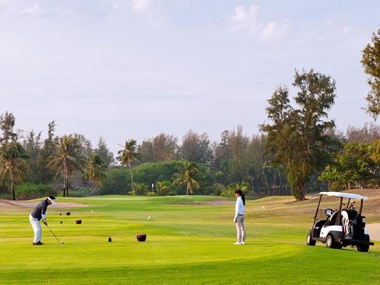 A golfer at a course in the central coastal town Phan Thiet, which used to force locals to make a long detour to the beach before being shut down. File photo
