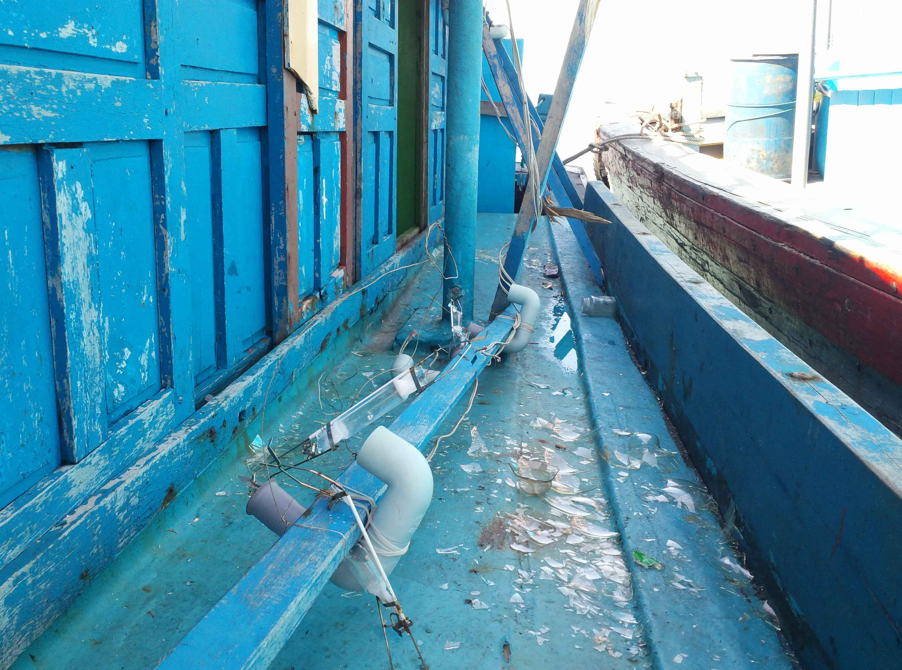 A Vietnamese fishing boat is damaged after an attack by a Chinese ship on July 21, 2015. Photo: Hoang Trong