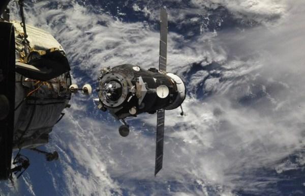 Russia's Soyuz Spacecraft Docks With International Space ...