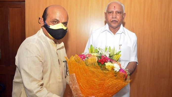 Basavaraj Bommai (left) with outgoing chief minister B.S. Yediyurappa   Twitter: @BSBommai
