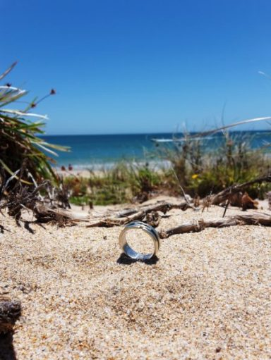 Lost engagement ring in the sand