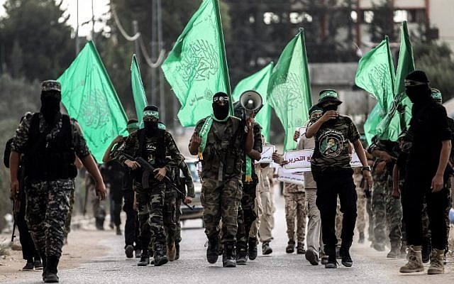 Masked youth cadets from the Ezzedine al-Qassam Brigades, the armed wing of Hamas, march in the southern Gaza Strip city of Khan Yunis on September 15, 2017. (AFP PHOTO / SAID KHATIB)