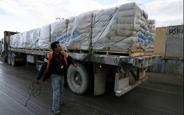 UN trucks carrying building materials for projects funded by UNRWA arrive in Rafah in the southern Gaza Strip after crossing the Israeli Kerem Shalom crossing on December 10, 2013. (Abed Rahim Khatib/Flash90)