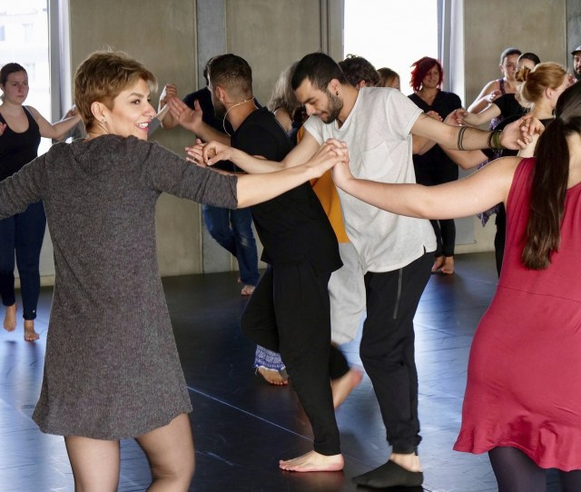In This April   Photo A Group Of People Take Part In A Workshop