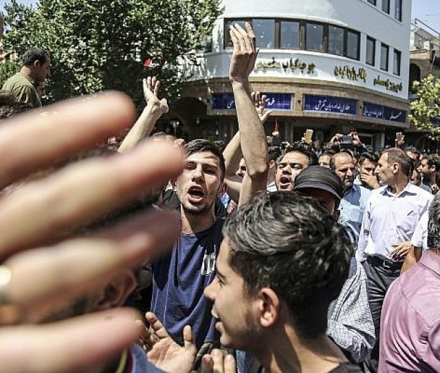 A Group Of Protesters Chant Slogans At The Main Gate Of Old Grand Bazaar In Tehran