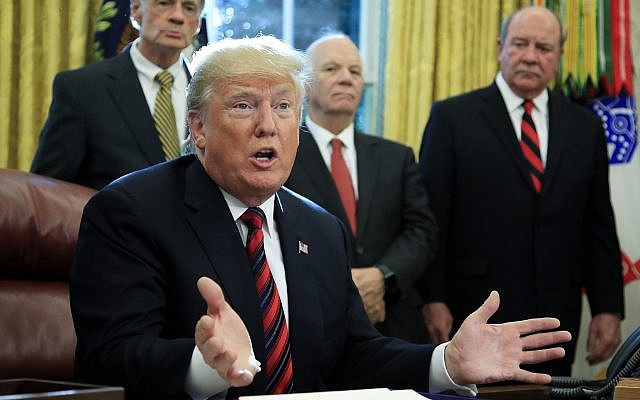 "President Donald Trump speaks following a ceremony signing the ""America's Water Infrastructure Act of 2018"" into law in the Oval Office at the White House in Washington, Tuesday, Oct. 23, 2018. (AP Photo/Manuel Balce Ceneta)"