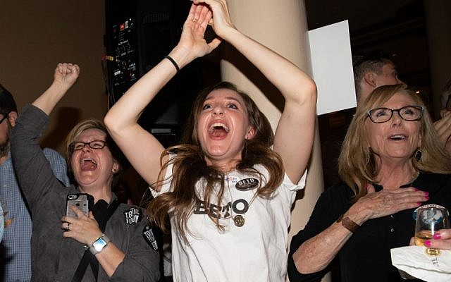 Women cheer as they watch election results at the Democrat Election Night Party held at The Driskill Hotel on November 6, 2018 in Austin, Texas. (SUZANNE CORDEIRO / AFP)