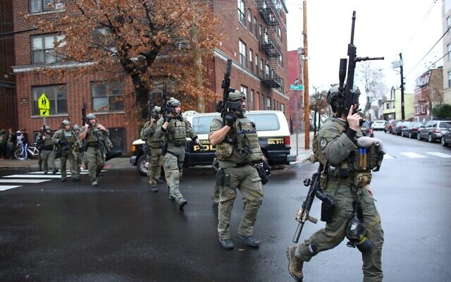 Police officers arrive at the scene of a shooting in Jersey City, New Jersey on December 10, 2019. (Kena Betancur/AFP)