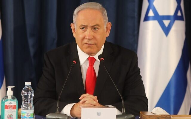 Prime Minister Benjamin Netanyahu chairs the weekly cabinet meeting in Jerusalem on June 7, 2020. (Menahem Kahana/AFP)