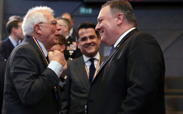 US Secretary of State Mike Pompeo, right, speaks with then-Spanish Foreign Minister Josep Borrell during a meeting of the North Atlantic Council at NATO headquarters in Brussels, December 4, 2018. (AP/Francisco Seco)