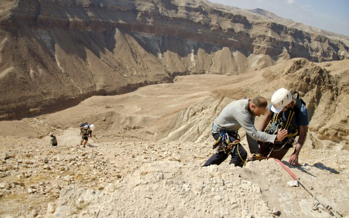 Rappelling to the Cave of the Skulls. (Yoli Schwartz, Israel Antiquities Authority)