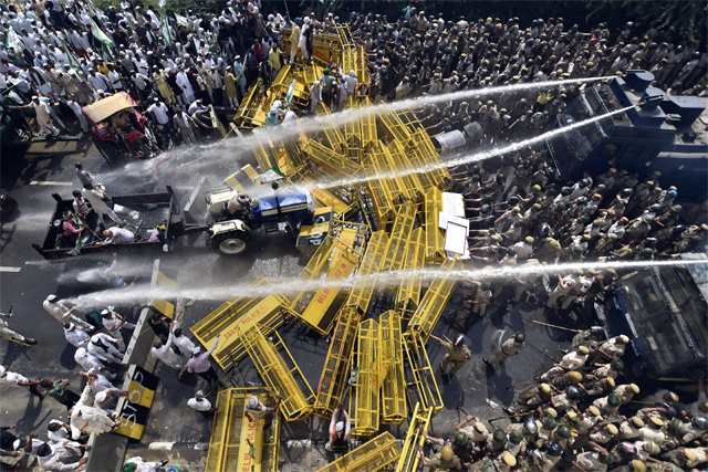 Police use water cannons to disperse farmers protesting at Delhi-UP border