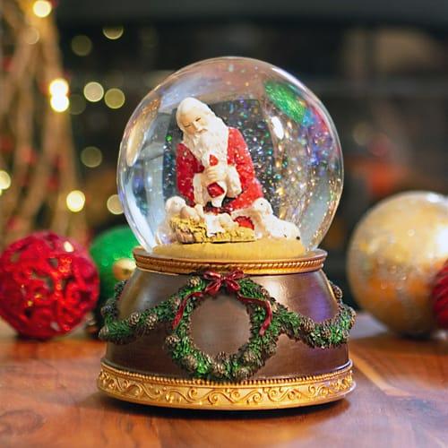 Kneeling Santa Musical Snowglobe The Catholic Company