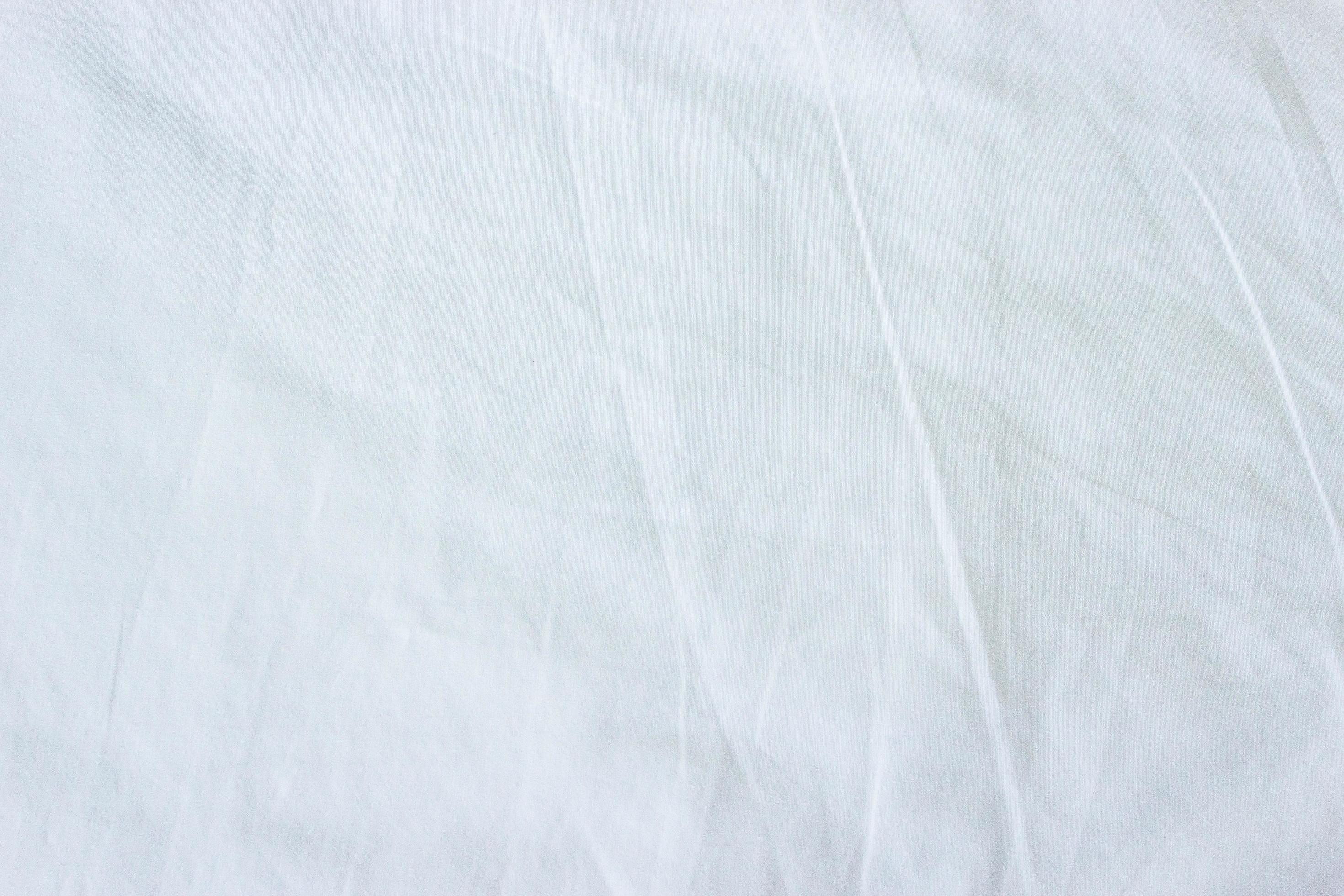 white fabric bed sheet stock photo
