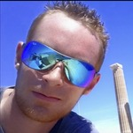 Passport picture of Matthew Woodward wearing sporty blue shades