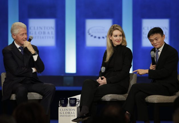 Former US President Bill Clinton and Theranos Founder and CEO Elizabeth Holmes listen as Alibaba Group Executive Chairman Jack Ma speaks during the Clinton Global Initiative annual meeting in New York on September 29, 2015.
