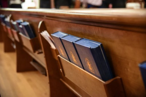 Bibles behind a pew