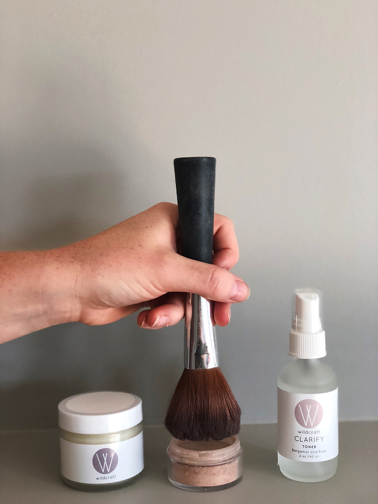 Dipping brush into Wildcraft skin care products