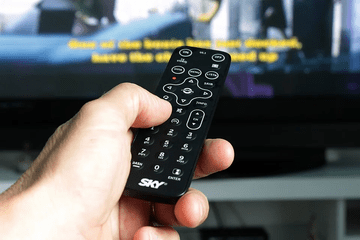 remote held in front of TV