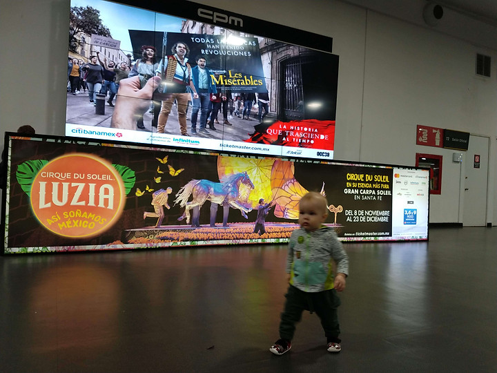 toddler running at the airport