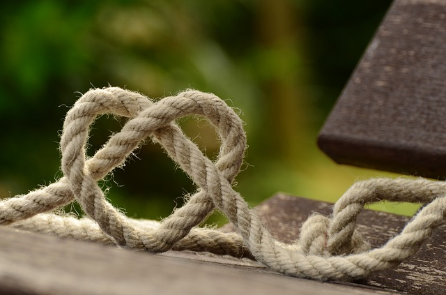 rope tied in the shape of a heart love letters entwined