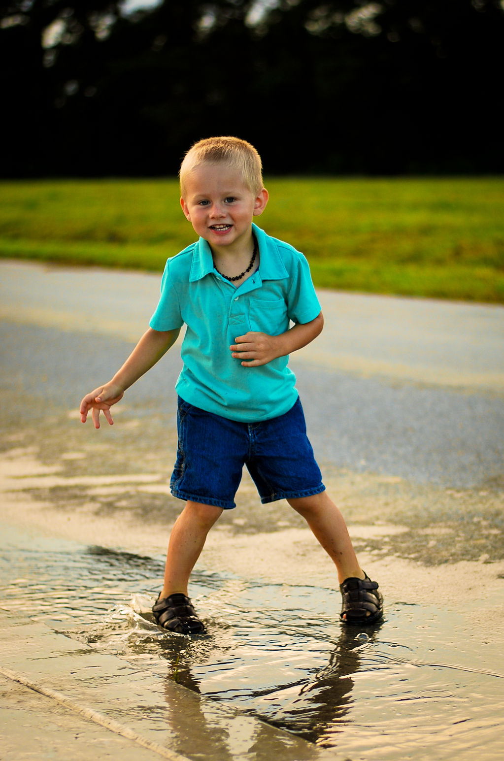 Toddler Portrait Photographer Playing in Puddle Rain