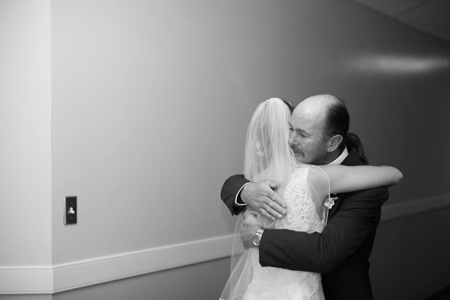Father and daughter on brides wedding day portrait