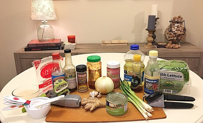 the ingredients and many supplies needed for this 1-pot asian chicken lettuce wraps