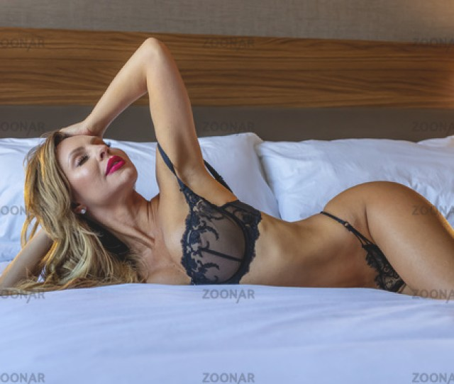 Beautiful Blonde Lingerie Model Relaxing At Home