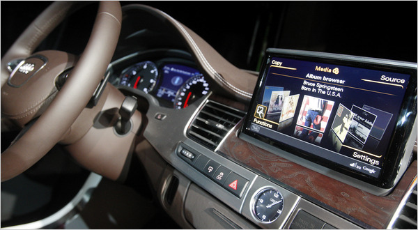 Despite Risks Carmakers Integrate The Web With The Dash The New York Times