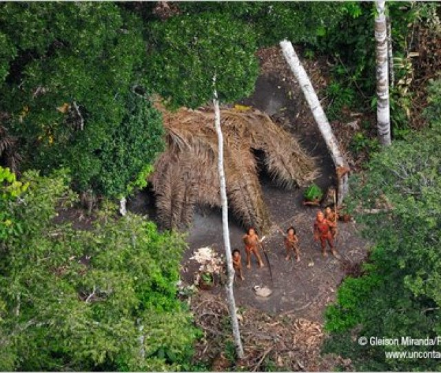 Members Of The Uncontacted Amazon Tribe In Western Brazil Near The Peruvian Border