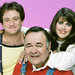 """Jonathan Winters, seated, with Robin Williams and Pam Dawber on the sitcom """"Mork & Mindy."""""""