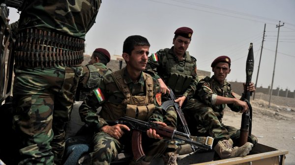 Kurdish Fighters Take a Key Oil City as Militants Advance ...
