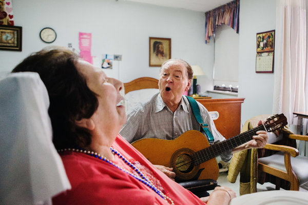 Mr. Palermo sings to his wife, plays her favorite songs, and feeds her home-cooked Italian meals.
