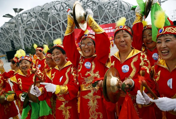Performers outside the National Stadium in Beijing on Friday cheered before the International Olympic Committee announced that the city had won its bid to host the 2022 Winter Games. CreditDamir Sagolj/Reuters