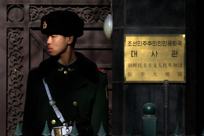 A Chinese paramilitary police officer standing guard outside the North Korean Embassy in Beijing. Credit Andy Wong/Associated Press