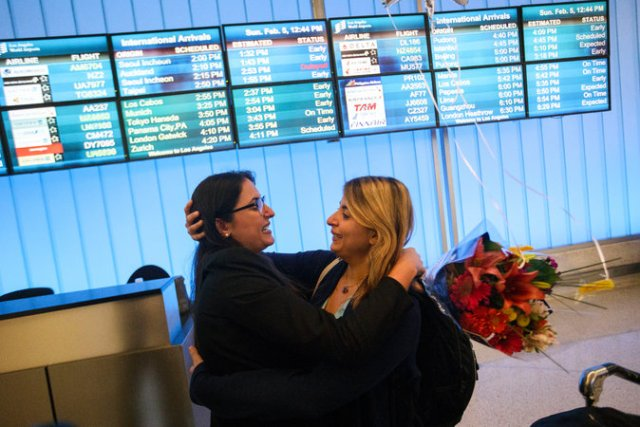 Sahar Muranovic, left, and her sister Sara Yarjani, an Iranian student who was detained for 23 hours and deported back to Vienna, were reunited at Los Angeles International Airport on Sunday.CreditPatrick T. Fallon for The New York Times