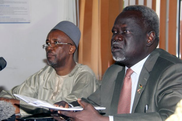 South Sudan's Minister of Health Dr. Riek Gai Kok, right, and Dr. Abdulmuini Usman, the World Health Organization country representative, at a news conference about the deaths of 15 children after a botched measles vaccination campaign in South Sudan. Credit Samir Bol/Associated Press. Courtesy New York Times.