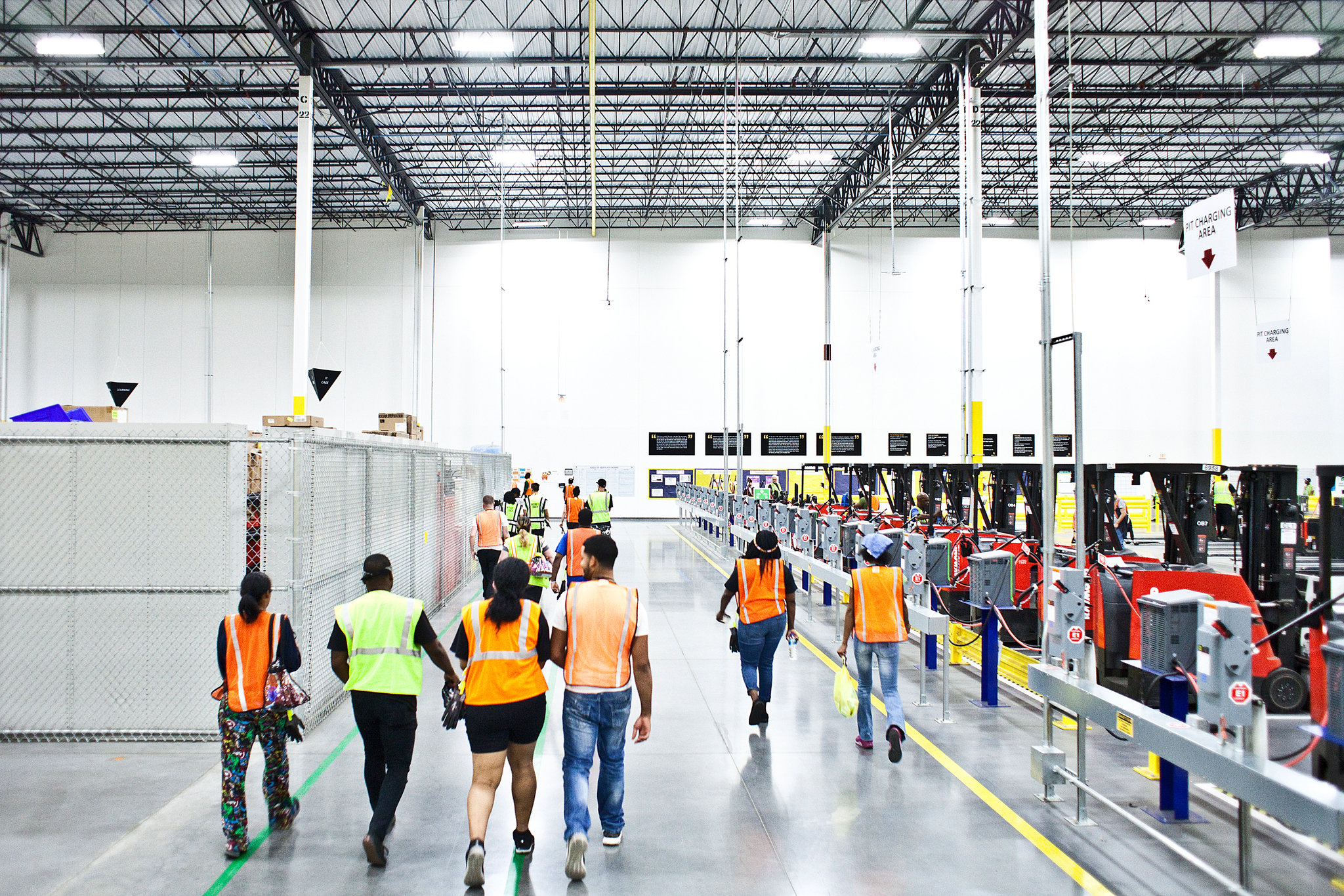 As Amazon Pushes Forward With Robots, Workers Find New