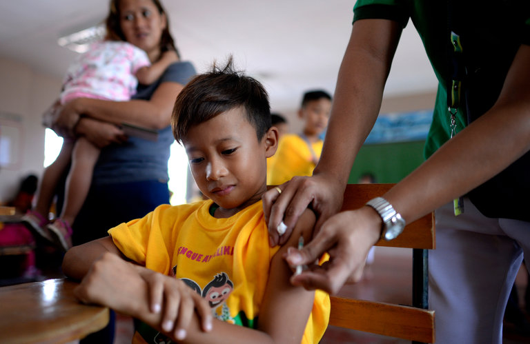 Philippines Suspends Dengue Shots After Drug Firm's ...
