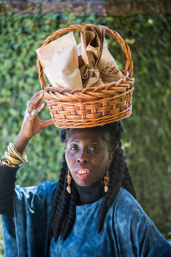 Queen Quet Marquetta L. Goodwine, the elected leader and official spokeswoman of the Gullah-Geechee Nation, traveled to Trinidad to walk rice fields tended by the Merikins.