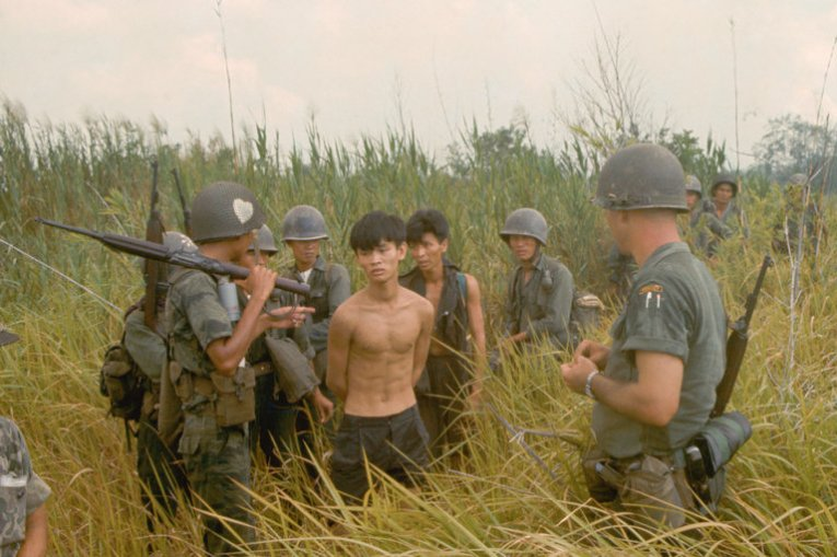What Was the Vietnam War About    The New York Times A group of South Vietnamese army soldiers and an American soldier with two  captured Vietcong suspects  in Plaines des Joncs  South Vietnam