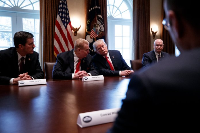 John Ferriola, Nucor's chief executive, with Mr. Trump at a round-table discussion on foreign trade and steel production in March.