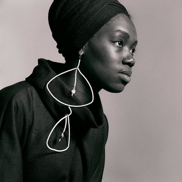 Untitled (Nomsa Brath with earrings designed by Carolee Prince), 1964.