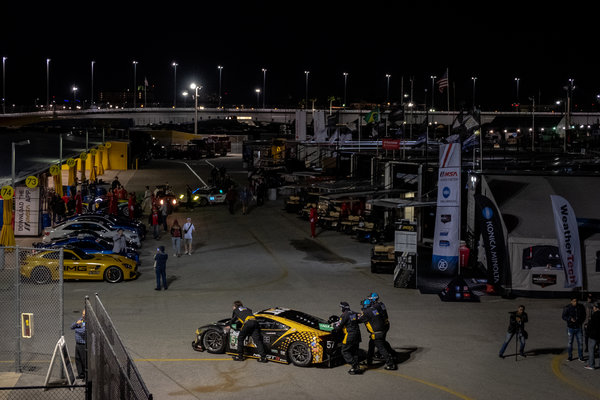 Pit workers pushing the Heinricher Racing car during preparations for the Rolex 24.