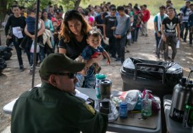 Migrants being interviewed by Border Patrol agents after being taken into custody last week in Los Ebanos, Tex. The Department of Homeland Security said that 104,344 people were detained in June.