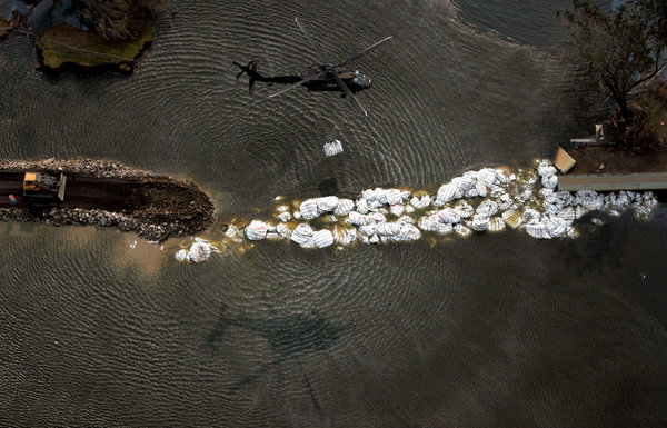 A military helicopter dropped a sandbag at the 17th Street Canal levee in New Orleans in 2005, in the aftermath of Hurricane Katrina.