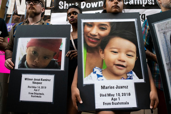 Demonstrators held photos of children who have died in detention during a rally Friday outside of the U.S. Immigration and Customs Enforcement office in Chicago.