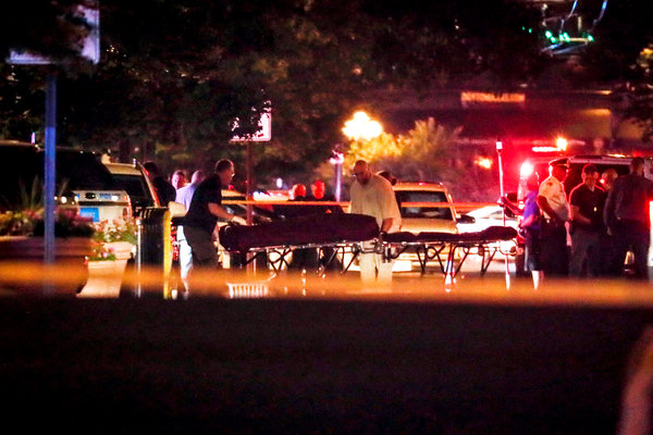 Bodies were removed from the scene of a mass shooting in Dayton, Ohio, on Sunday.